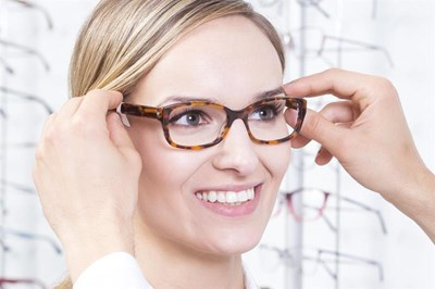 Woman having glasses fitted