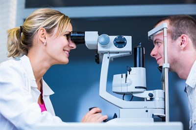 Optometrist examining patient