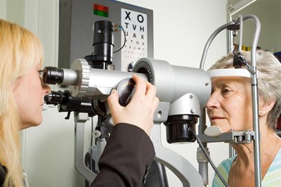 A woman having her eyes tested in practice