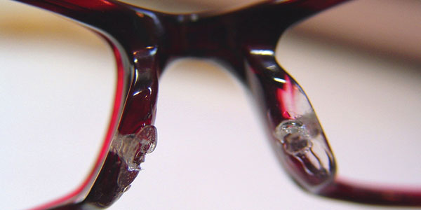 Adapting frames: Nose pad repair on a child\'s frame - Optician