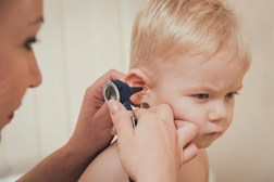 Gaining the trust of a child is key to an ear exam