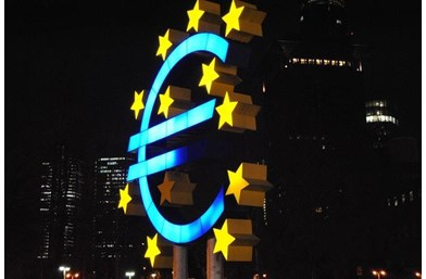 Giant Euros symbol against building backdrop