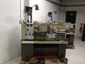 Used Harrison M300 Gap Bed Lathe with DRO.