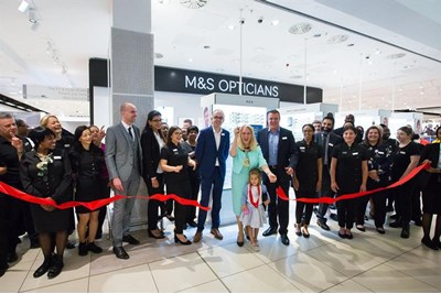 Red ribbon being cut at M&S Westfield opening