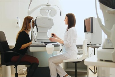 Woman having eye test