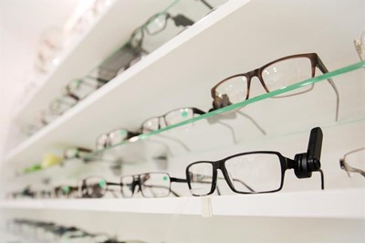 Spectacles on shelves