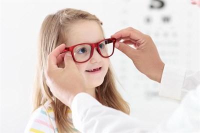 Girl having glasses fitted