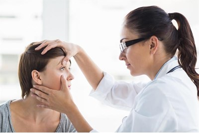 Woman having contact lens fitted