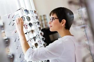 Woman choosing glasses