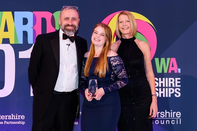 Beth Addis (centre) collecting her award