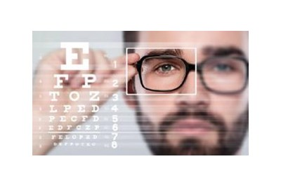 Person wearing glasses and a testing chart