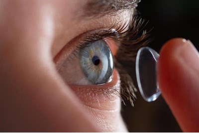 Person applying a contact lens
