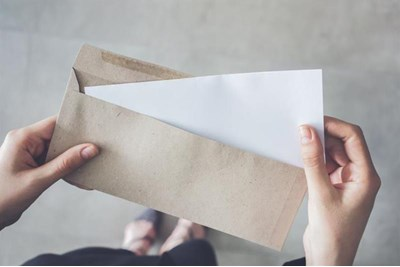 Person opening letter