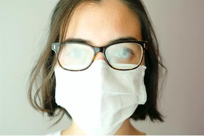 Person in mask and glasses that have steamed up