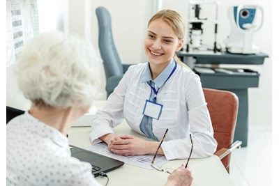 Optometrist talking to a patient