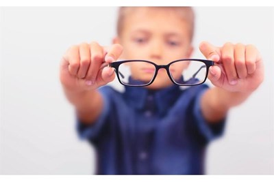 Child holding spectacles