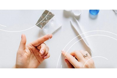 Person handling contact lenses